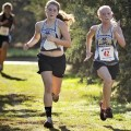 Henrietta's Joyana Zamzow and Mahalah Womack compete in the District 9-AA Cross Country Meet in Wichita Falls Monday.