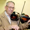 "Raymond ""Eoogie"" Edwards of Joy performed as a fiddle player for more than 70 years. He and Brother Loyd Edwards formed the Post Oak Fiddle Band in 1939."