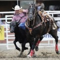 Mickey Gee competes in the seventh performance of the Calgary Stampede. Gee threw his steer in 4.0 seconds to split first place in the go-round. (Photo by Mike Copeman Photography)