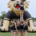 Henrietta's varsity cheerleaders entertain the crowd during Friday's Meet the 'Cats event at Bearcat Stadium.