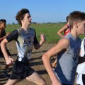 Varsity runner Donovan Cook (center) represents Henrietta in the Shade Tree Run cross country meet held Saturday in Muenster.