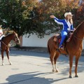 Pioneer Reunion Rodeo Queens Kat Hand and Josey Cleveland represent Clay County in the Wichita Falls Veterans' Day Parade. (Photo courtesy Regina Hand)