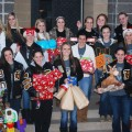 "Members of the Henrietta varsity and JV Lady Cats raised $250 through bake sales to purchase Christmas gifts and groceries for a Henrietta family. The community service project is called ""Hoops for Help."""