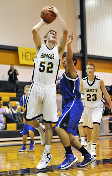 Bearcat Cole Burns shoots for two during Henrietta's 75-53 win over City View Tuesday night.