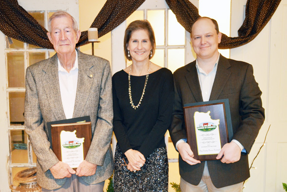 The Henrietta and Clay County Chamber of Commerce honored three of its own Saturday, present Gene Allmand with the oraganization's Individual of the Year award, the Clay County Christmas Lighting Project, represented by Kay Lynn Gonzenbach, with the Community Beautification award, and The Pioneer Sentinel, represented by Matt Kelton, with Business of the Year.