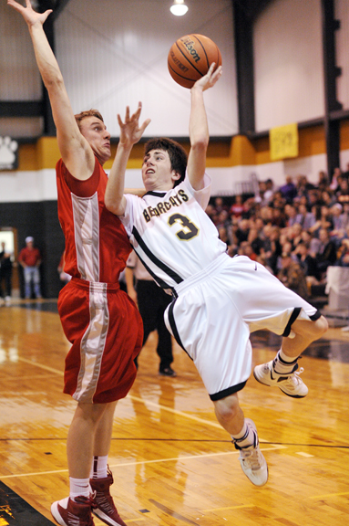 Henrietta's Dalton Davidson is fouled on a jump shop in the second half of Tuesday's game against Holliday, earning a trip to the free throw line.