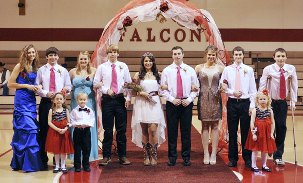 Members of the Midway homecoming court are (back) Kelli Forester, escort Ben Forester, Racheal Keener, escort Mark Nall, Queen Breanna Merkel, escort Brent Jones, Macy McDaniel, escort Brody Wilson, and escort Jsoh Fulbright, (front) flower girl Allison Marshall, ring bearer Rnadall Capps and flower girl Faith Vogel.