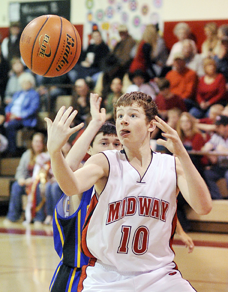 Midway's Chance Horn reaches for a loose ball Friday night against Prairie Valley.