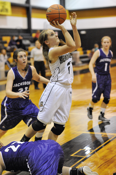 Lady Cat Annelise Sauer pulls away from a Jacksboro defender to shoot a short jump shot Tuesday night.