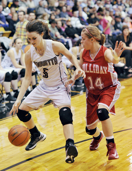 Henrietta's Anni Scholl drives past a Holliday defender Tuesday night.