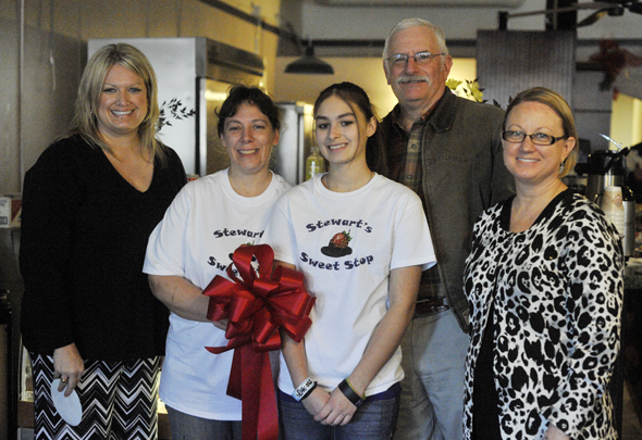Beth Stewart, owner of Stewart's Sweet Stop, is pictured with daughter Brandy, Betty Ellsworth, executive director of the Henrietta and Clay County Chamber of Commerce,  Chamber President Randy Schaffner and 2012 President Kathy Pierce during Wednesday's ribbon cutting.