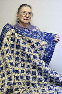 Nell Howard, a member of the Clay County TEEA, won a Cathedral Window coverlet designed and quilted by the organization.