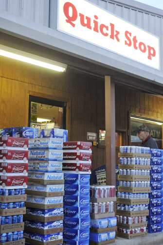 Cases of beer line are lined up in front of the Henrietta Quick Stop Friday. The convenience store became the first place in Henrietta to purchase alcoholic beverages.