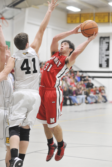 Midway's Ben Forester shoots against Bellevue's Tyler Terry Friday night. The Falcons earned a 10-point win.