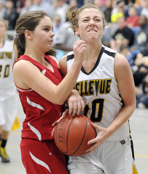 Bellevue's Bailey Schroeder is fouled by Lady Falcon Marley Tate in the fourth quarter Friday night.