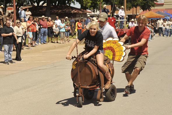 Seniors from Henrietta High School compete in last year's inaugural Turkey Fest Scholarship Barrel Race.