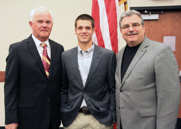 Henrietta High School senior Joe Dell Williams has been selected as a President's Leadership Scholar at Seminole State College where he will also be a member of the Trojan baseball team.  Williams (center) is congratulated by SSC Trojan Baseball Coach Lloyd Simmons (left) and SSC President Dr. Jim Utterback.