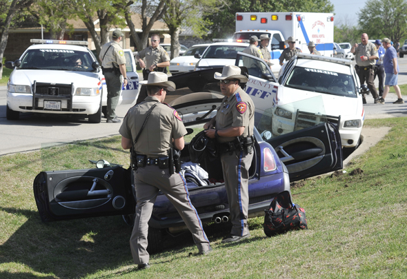 DPS Troopers search the contents of a car used to lead law enforcement on a high-speed chase through three counties Sunday. The chase ended in Byers when the car struck a Wichita County patrol vehicle.
