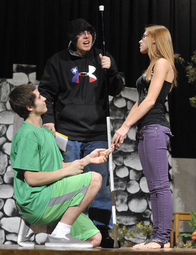 """Romeo"" Kaleb Gwinn, and ""Juliet"" Serenity McNett are joined on stage by Trent Yurch in the role of Monk Larry during play practice Sunday afternoon. The Henrietta High Class of 2013 presents ""The Seussification of Romeo and Juliet"" on Saturday."