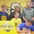 Tyler Terry, pictured with his parents and siblings, signed a letter of intent Tuesday night to play basketball for Wayland Baptist University.