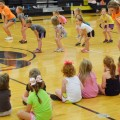 Campers attending the Henrietta High School mini spirit camp practice a cheer dance.