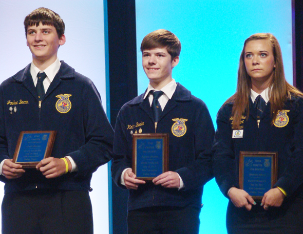 Kolton Beeler, center, is recognized as a finalist for the Texas FFA Star finalist in ag production.