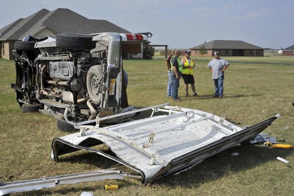 A camper shell and pickup lay in the front yard of a Dean residence after a one-vehicle rollover Monday afternoon.