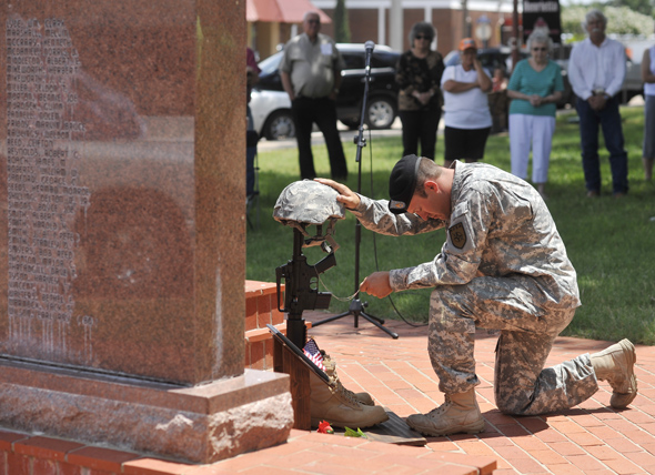Sgt. Matt Rick of the Iron Soldiers organization pauses during a battlefield cross ceremony held Monday in Henrietta.