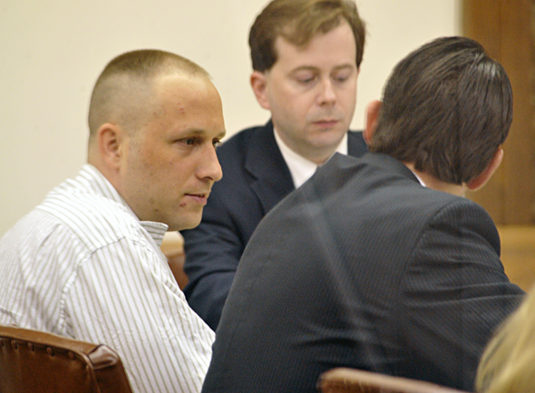 Justin Wayne Green (left) talks to his attorney during Monday's testimony.