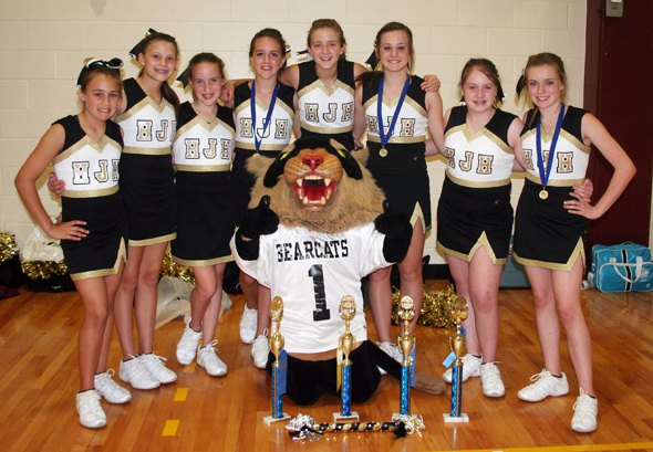Henrietta Junior High cheerleaders are Madison Christian, Rachell Morrow, Leah Bullinger, Addie Duncan, Audrey Gallagher, Maddie Brown, Ashlyn Chesser, Alexis Roberts and Mascot Katie Newberry.