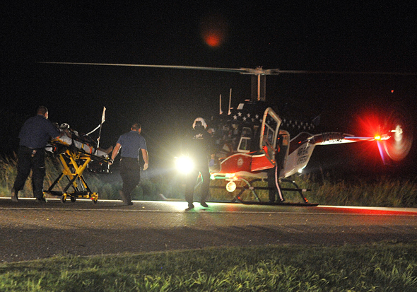 Arnold Ayla of Wichita Falls is moved to a helicopter after he was struck by a vehicle near Bellevue late Wednesday night.