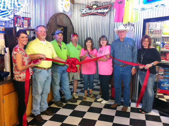 The Henrietta and Clay County Chamber of Commerce held a ribbon cutting ceremony Saturday to help celebrate the grand opening of The Top Shelf Spirits Beer and Wine. Pictured are B.J. Dunn, executive director of the chamber of commerce; Duaine Covert, chamber of commerce director; Donald Biehl, Craig Rhodes, Angela Rhodes, Laton Biehl, owners; Randy Schaffner, chamber of commerce president; and Danelle Lee, chamber of commerce secretary.