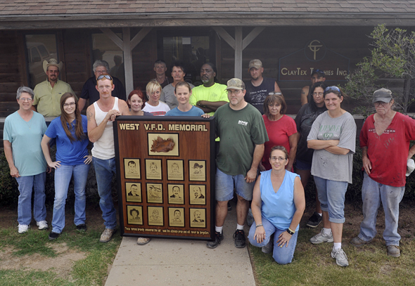 Robert Reams and ClayTex Trophies President Jack Ellis (back row, far left) with employees who assisted in the design and construction of a memorial for the West, Texas, VFD. Reams' wife Susan is a native of West and has two brothers who serve on the WVFD.