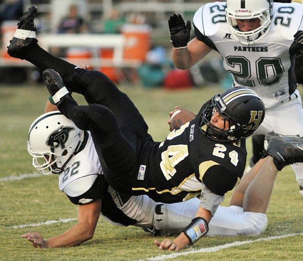 Henrietta's Leo Hunter is brought down by Paradise linebacker Austin Hogan. Henrietta earned a 22-6 win over Paradise during homecoming.