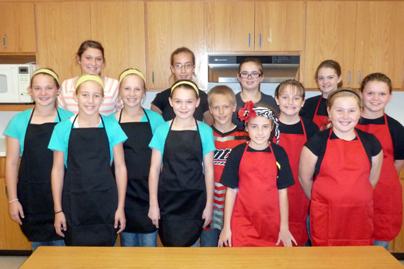 Students who competed in the Clay County 4-H Food Challenge are (front) Kylee Erickson, Kylee Halter, Kalico Burkes, Kat Hand, Logan Taylor, Layton Graham, Madeline Catron, Hadley Gee, Rexa Hand, (back) Lauren Taylor, Heather Taylor, Regan Seigler and Camrin Byers.