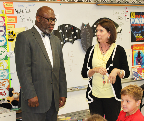 Commissioner of Texas Education Michael Williams speaks with fourth grade teacher Tricia Campbell during a tour of the Henrietta ISD campuses Tuesday.