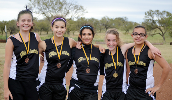 Lady Cats Tee Lee Cook, Kaci Williams, Marisa Rodriguez, Leah Bullinger and Isabella Garcia earned the team title in the junior high girls race at the Henrietta Invitational Oct. 5.