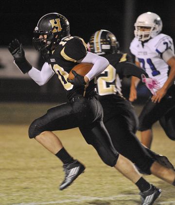 Henrietta's Aaron Whitehead breaks for an 88-yard kickoff return for a touchdown in the second quarter Friday night.