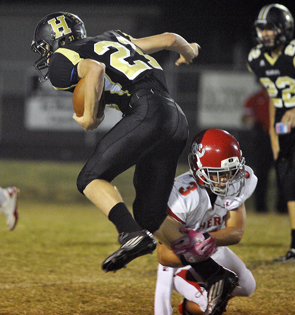Sophomore Bearcat Cody Fletcher leaps through a Holliday defender during Friday's 34-13 win over the Eagles.