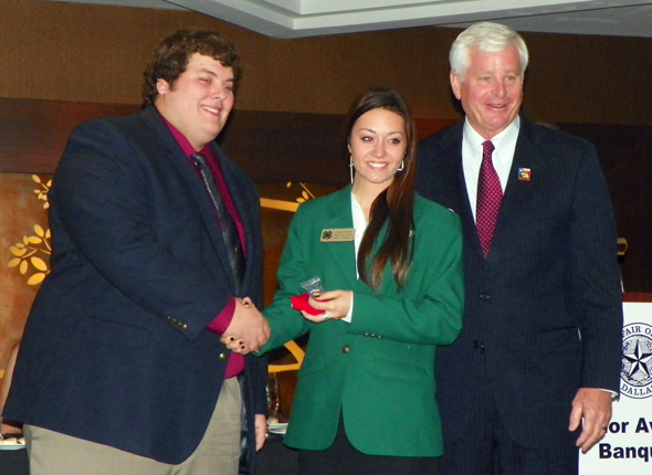 State 4-H Council member Cassie Pickett of Henrietta, with Alan Walne, State Fair of Texas board member, and Bruce A. Sifford, chairman of the Executive Livestock Committee for the State Fair of Texas.