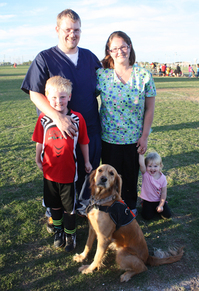 Blake Fields with dad Shelby, mom Jessica, sister Sadie and Ginger, a diabetic alert dog.