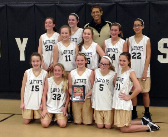 "Henrietta's seventh grade ""black"" Lady Cats earned a championship title in the Henrietta Junior High ""B"" tournament Saturday, Dec. 14."