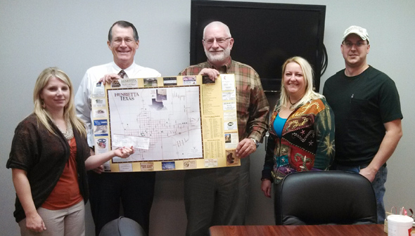 Curtis Courtney with Morning Star Publishing presents Henrietta and Clay County Chamber of Commerce President Randy Schaffner with the new Henrietta and Clay County maps and a donation to the Chamber.  Joining in the presentation are board members Amy Ellis, K.J. Davidson and Michael Russell.