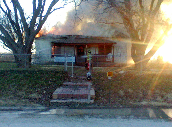 Fire fighters responded to a structure fire in the 100 block of North Byers Road Wednesday morning. The home of John and Jan Auchmoody is a total loss.