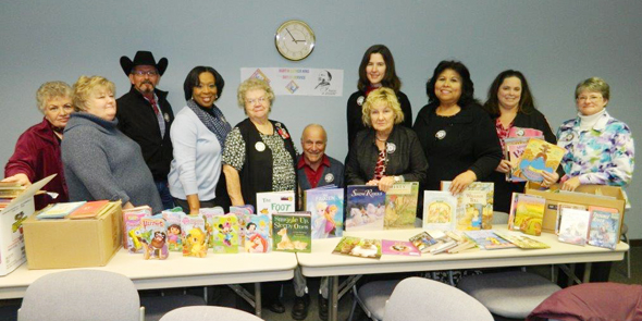 The Retired and Senior Volunteer Program of North Texas advisory council, including Precinct 2 Commissioner Johnny Gee, staff and volunteers prepare for delivery of books donated as a part of the Texas Senior Corps statewide effort in celebration of Martin Luther King Day to benefit school children in West, Texas.