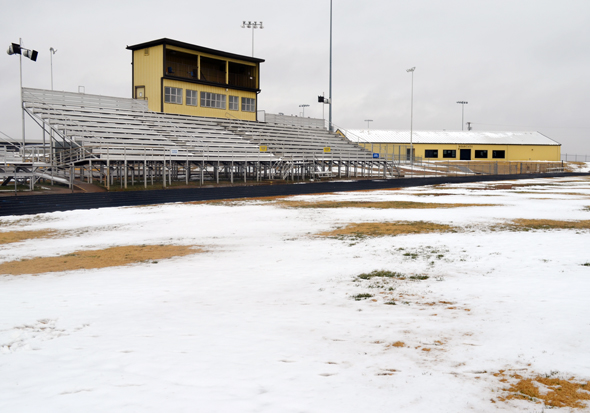 Snow covers grass turf of the Henrietta ISD football field Tuesday morning. District trustees voted Thursday to install artificial turf on the football, baseball and softball fields as part of a school renovations package.