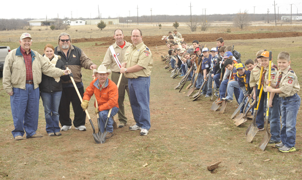 Cub Scouts, Boy Scouts and Eagle Scouts from Pack 92 and Troop 91 join Doyle Davis, Tiffany Sears Leach (standing in for Cub Master Derek Leach), M&F Litteken President Kevin Darnell, Scoutmaster Joe Bill Brock, Mike Brown and Bryce Seigler for a groundbreaking ceremony Saturday. Davis, Derek Leach, Brock, Brown and Seigler, as well as Hank Bullinger, Brad Yurcho, Laura Lee Brock and Vicki Yurcho serve on the Henrietta Boy Scouts, Inc. board of directors.