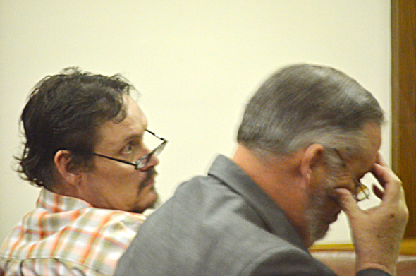 Norman Olson, seated next to defense attorney Marty Cannedy, was convicted Thursday in the continuous sexual assault of a 12-year-old girl.