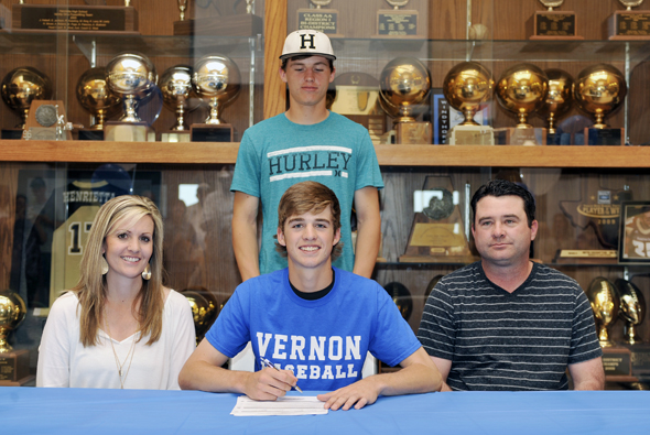 Henrietta senior Conner Fletcher signs a letter of intent with Vernon College as parents Shannon and Ellis Fletcher and brother Cody Fletcher look on.