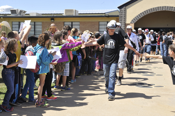 Students from Henrietta Elementary lined the sidewalk at Henrietta High School to give the Bearcat baseball team a big sendoff  Thursday. Henrietta drubbed Merkel in two games, 7-1 and 15-1.
